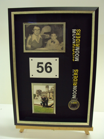 Framed medal & photographs