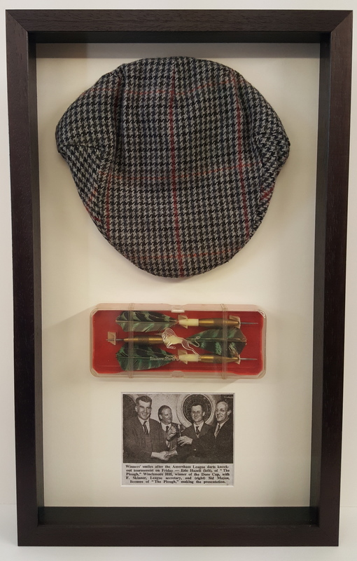 Flat cap & darts framed
