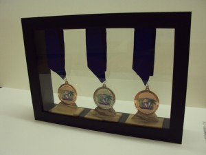 Dragonboat Medals framed by Bespoke Framing