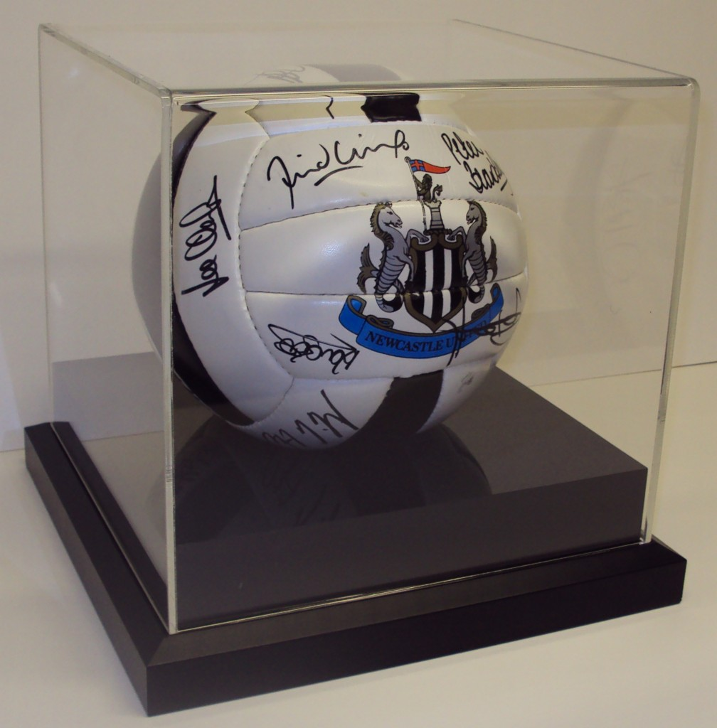 Framed Football on plinth with acrylic dome