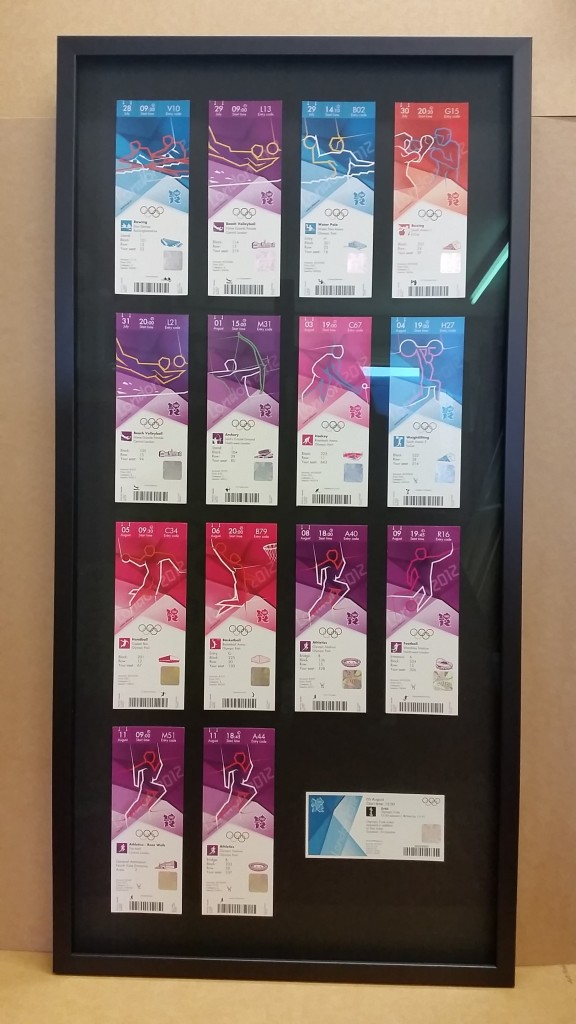 Olympic tickets collection framed in a black frame with a black backing