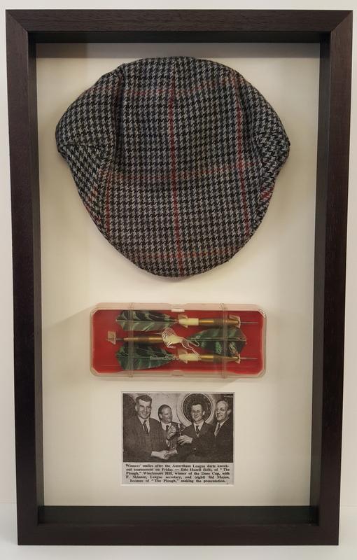Flat cap & darts framed