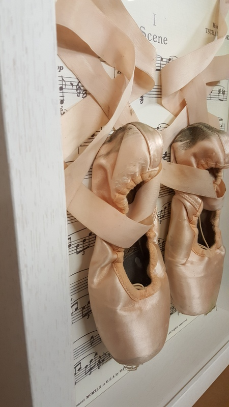 Ballet Points in a deep white shadow box against the music of Swan Lake