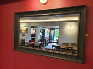 Framed Mirror in cassetta black distressed frame
